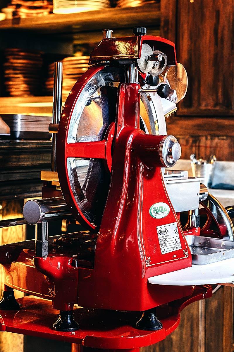 red retro prosciutto slicing machine