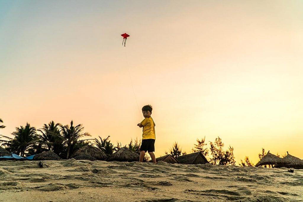 child on cua dai beach