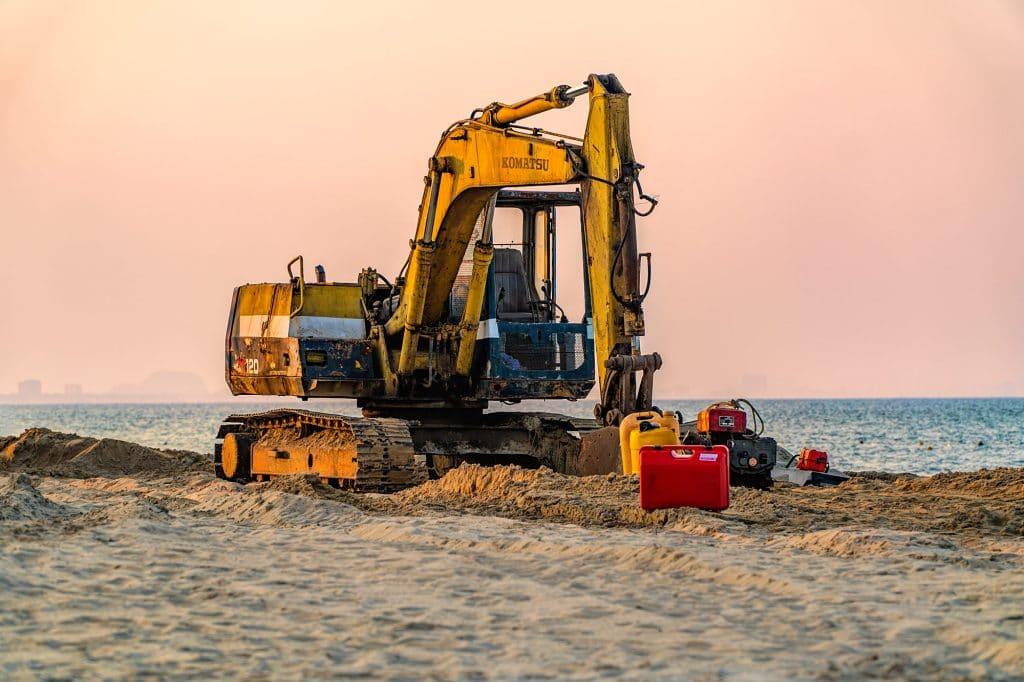 excavator on cua dai beach