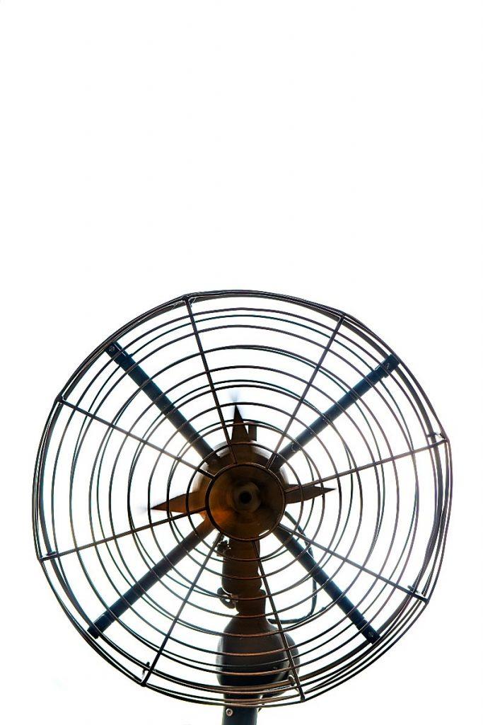 metal fan on white