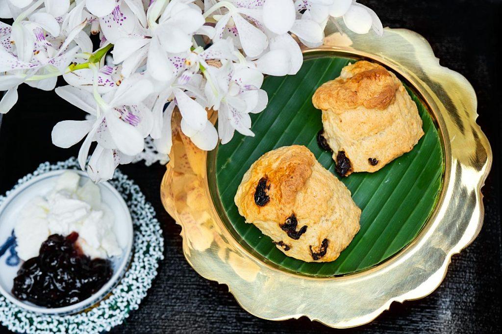 raisin scones with clotted cream and jam