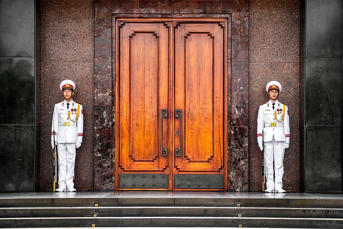 vietnamese guarding doors